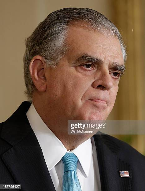 Outgoing Secretary of Transportation Ray LaHood listens as US President Barack Obama introduces Charlotte Mayor Anthony Foxx as the nominee for...