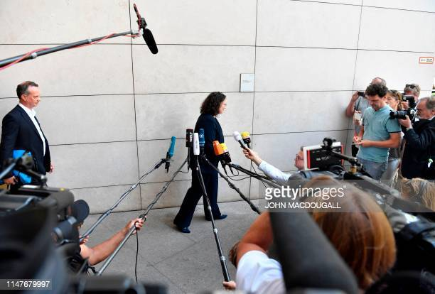 Outgoing Social Democratic Party leader Andrea Nahles leaves after giving a press statement on June 3, 2019 in front of her SPD party's headquarters...