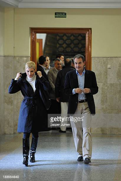 Outgoing Spanish prime minister Jose Luis Rodriguez Zapatero of the Socialist Party arrives with his wife Sonsoles Espinosa to cast his ballot for...