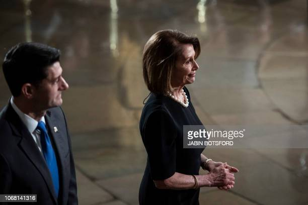 Outgoing Speaker Paul D Ryan and House Minority Leader Nancy Pelosi walk away after paying their respects to former president George HW Bush as he...