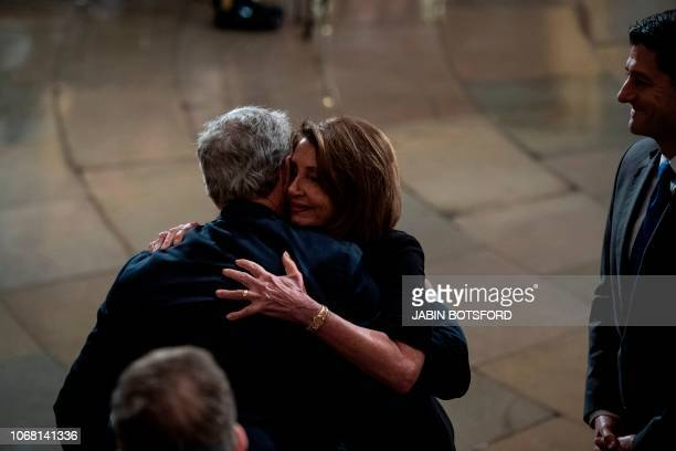 Outgoing Speaker Paul D Ryan and Nancy Pelosi greet former president George W Bush after paying their respects to former president George HW Bush as...