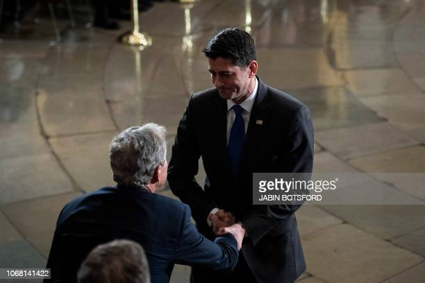 Outgoing Speaker Paul D Ryan greets former president George W Bush during a ceremony for former president George HW Bush as he lies in State at the...