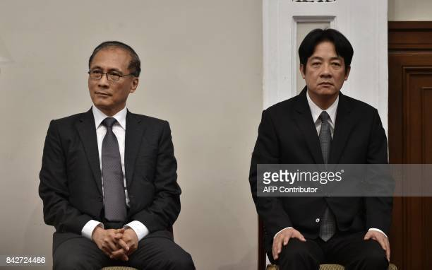 Outgoing Taiwan premier Lin Chuan sits next to newly appointed Premier William Lai during a press conference at the Presidential Palace in Taipei on...