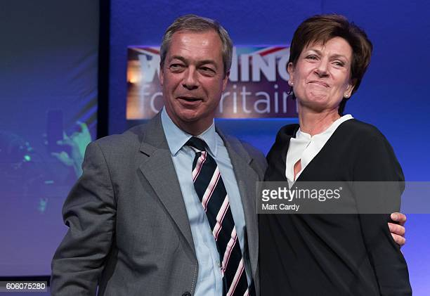 Outgoing UKIP leader Nigel Farage congratulates MEP Diane James after she was announced as the new leader of UKIP at the Bournemouth BIC where the...