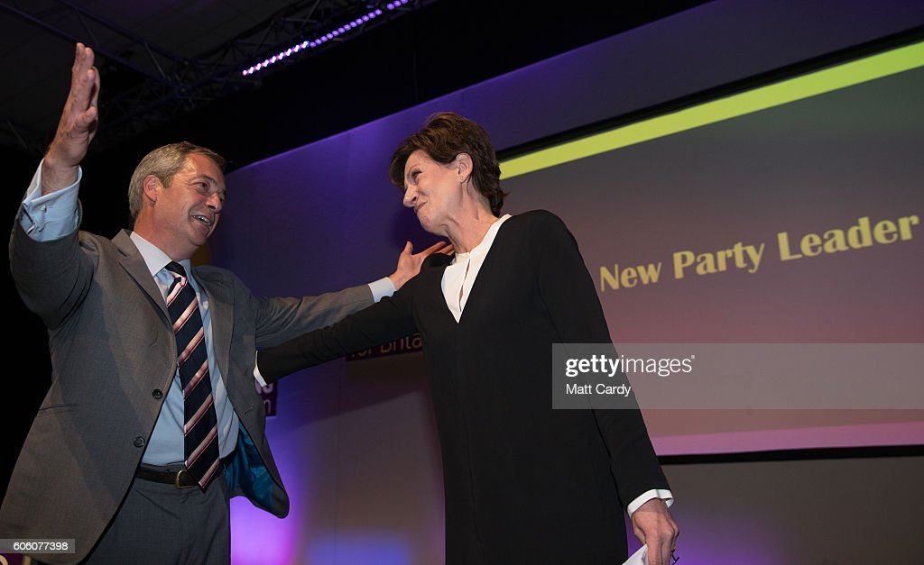 Outgoing UKIP leader Nigel Farage congratulates MEP Diane James after she was announced as the new leader of UKIP at the Bournemouth B.I.C where the United Kingdom Independent Party are holding their annual conference on September 16, 2016 in Bournemouth, England. UKIP are holding their first conference since the historic vote by the UK to leave the European Union. The conference is the last Nigel Farage will attend as leader after it was announced today that MEP Diane James will take up the position.