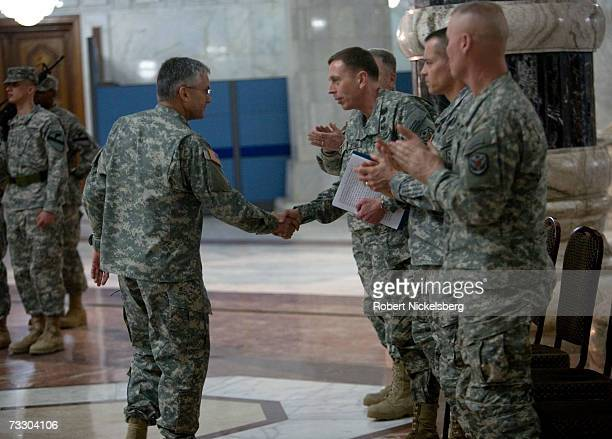 Outgoing US Army General George W Casey Jr Commander of MultiNational ForcesIraq shakes the hand of General David H Petraeus during the change of...