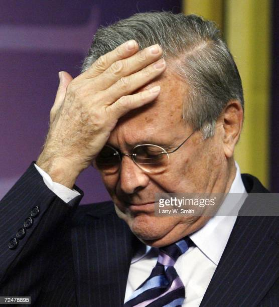 Outgoing US Defense Secretary Donald Rumsfeld holds his head before delivering the 146th Landon Lecture inside Bramlage Coliseum at Kansas State...