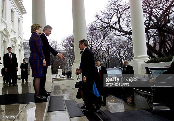 Outgoing US President Bill Clinton and First Lady Senator Hillary Rodham Clinton greet US President elect George W Bush and his wife Laura on the...