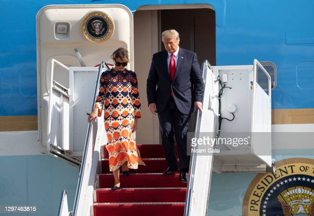 Outgoing U.S. President Donald Trump and First Lady Melania Trump exit Air Force One at the Palm Beach International Airport on the way to Mar-a-Lago...