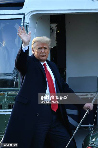 Outgoing US President Donald Trump waves as he boards Marine One at the White House in Washington, DC, on January 20, 2021. - President Trump travels...