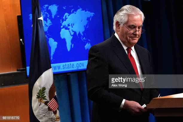 Outgoing US Secretary of State Rex Tillerson leaves after he made a statement on his departure from the State Department March 13 2018 at the State...