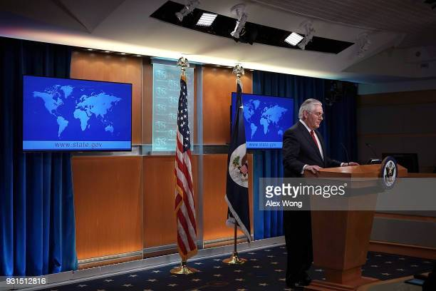 Outgoing US Secretary of State Rex Tillerson pauses as he makes a statement on his departure from the State Department March 13 2018 at the State...