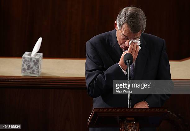 Outgoing US Speaker of the House Rep John Boehner wipes his eye as he gives his farewell speech in the House Chamber of the Capitol October 29 2015...