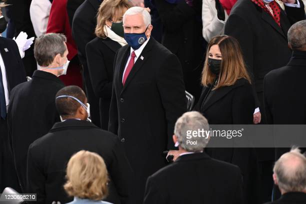 Outgoing US Vice President Mike Pence and US Second Lady Karen Pence arrive during the 59th Presidential Inauguration at the U.S. Capitol on January...