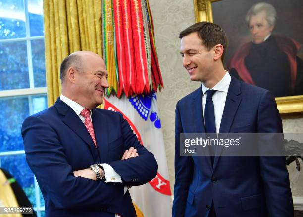 Outgoing White House Chief Economic Adviser Gary Cohn talks to White House Advisor Jared Kushner as they attend a meeting with President Donald Trump...