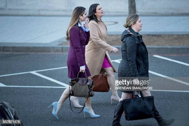 Outgoing White House Comunications Director Hope Hicks and White House Press Secretary Sarah H Sanders leave the White House March 16 2018 in...