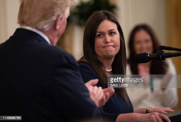 TOPSHOT Outgoing White House Press Secretary Sarah Huckabee Sanders speaks alongside US President Donald Trump during a second chance hiring and...
