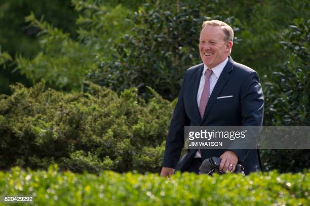 Outgoing White House Press Secretary Sean Spicer smiles as he walks to the West Wing of the White House in Washington DC on July 21 2017 Spicer...