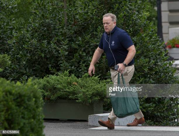 Outgoing White House Spokesman Sean Spicer walks into the West Wing of The White House on July 29 2017 in Washington DC