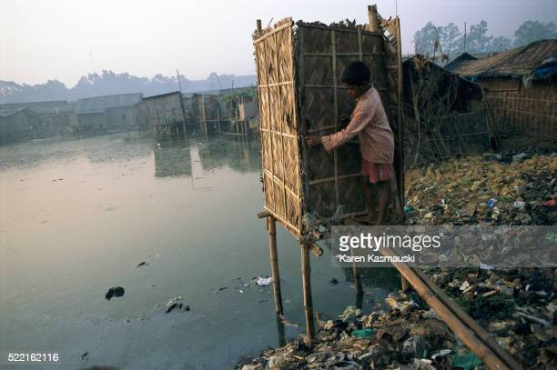 Outhouse Elevated Over Pond in Bangladesh