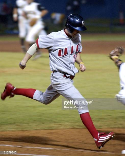 Outielder Ted Rosinski of the Univeristy of IllinoisChicago Flames legs one out as they are defeated by the Long Beach State Dirtbags 5 to 3 on...