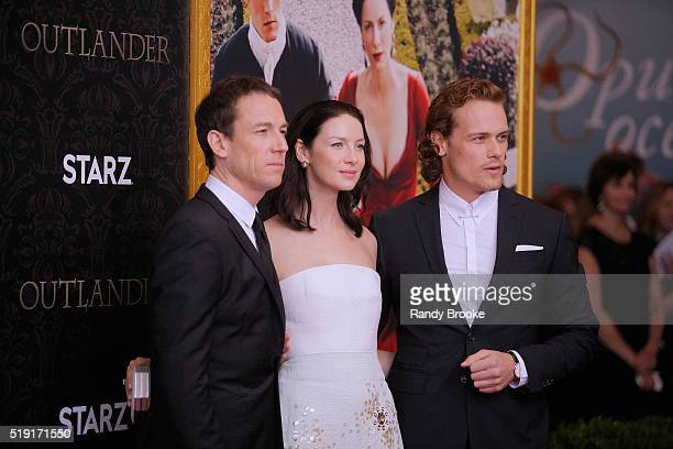 "Outlander actors Tobias Menzies who plays Frank Randall/Jonathan ""Black Jack"" Randall, Caitriona Balfe and Sam Heughan attend the Season Two World..."