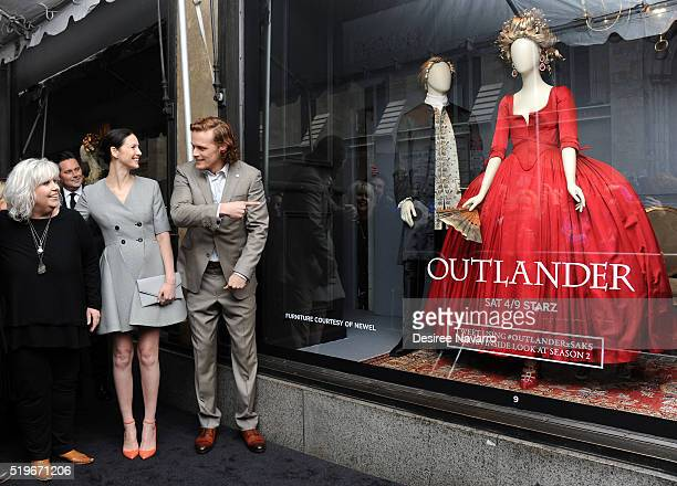 'Outlander' Costume Designer Terry Dresbach actors Caitriona Balfe and Sam Heughan attend Saks Fifth Avenue 'Outlander' Window Display Unveiling at...