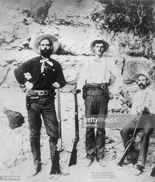Outlaw Jesse James with members of his gang probably two of the Younger brothers