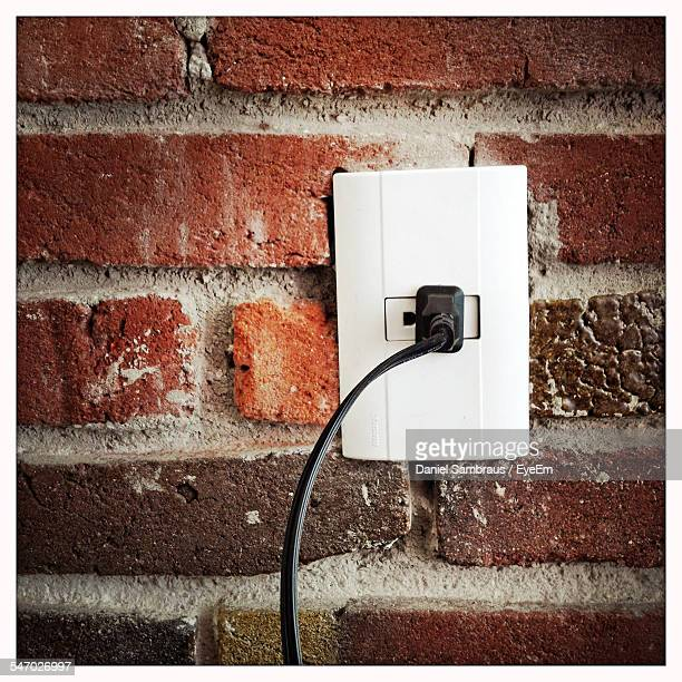 Outlet In Brick Wall