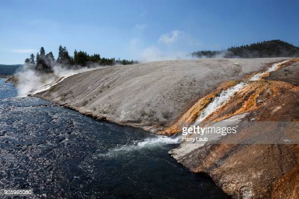 Outlet of the Excelsior Geyser in the Firehole River with mineral deposits, Midway Geyser Basin, Yellowstone National Park, Wyoming, USA