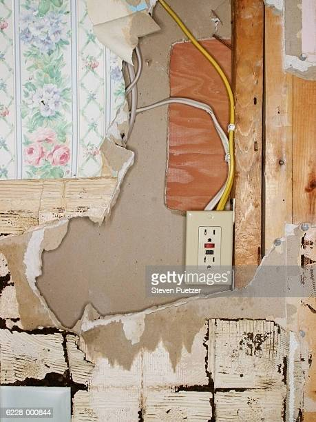 Outlet on Damaged Wall