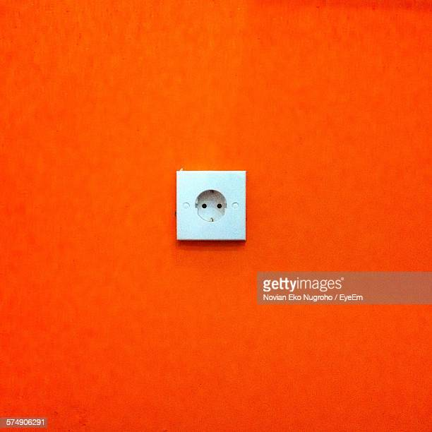 Outlet On Orange Wall