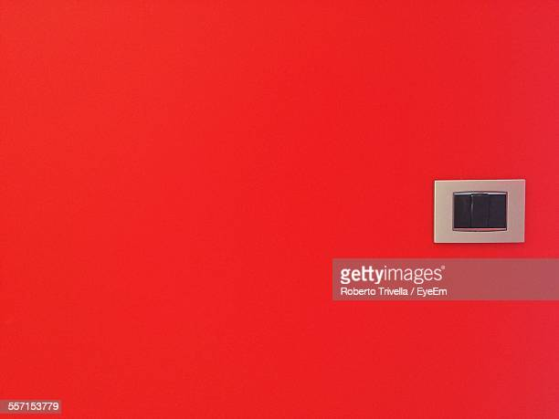 Outlet On Red Wall