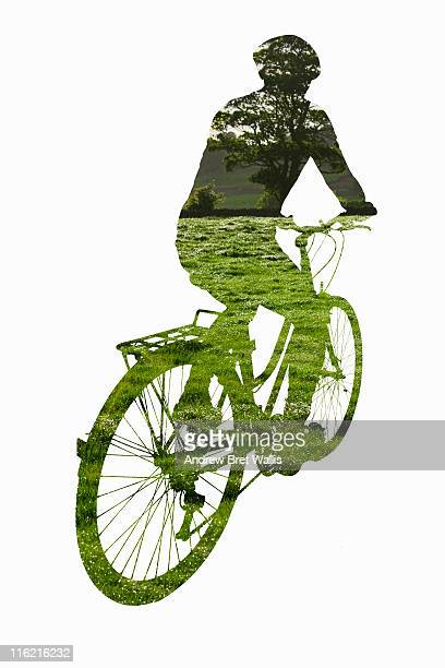 outline of male cyclist against a green landscape