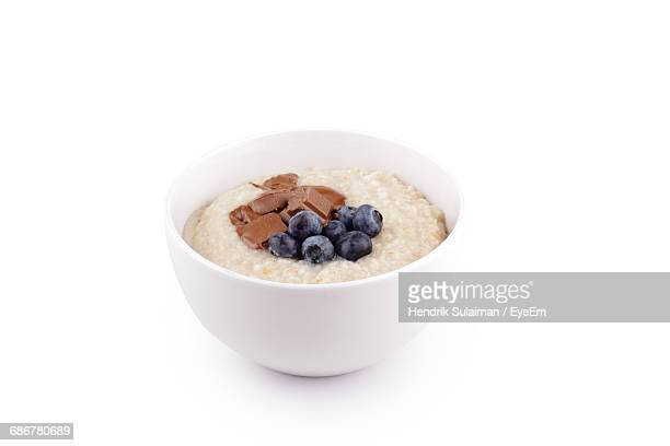 outmeal with chocolate and blueberries - oatmeal stock photos and pictures
