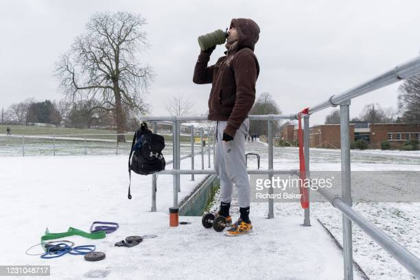 Out-of-work chef Phil, exercises alone in a snowy landscape at the empty open-air gym in Brockwell Park, south London during the third lockdown of...