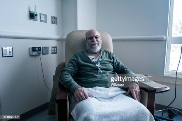 outpatient senior adult man cancer patient during chemotherapy iv infusion - outpatient care stock pictures, royalty-free photos & images