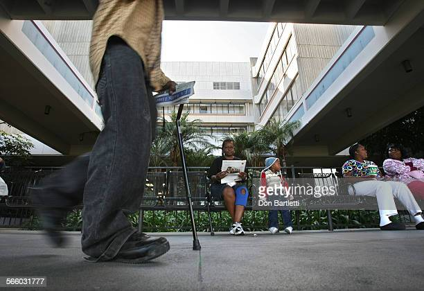ANGELES CA Outpatients and family members of those receiving care wait outside Martin Luther King Jr Hospital The hospital currently operates as a...
