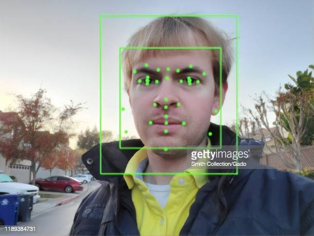 Output of an Artificial Intelligence system from Google Vision, performing Facial Recognition on a photograph of a man, with facial features...