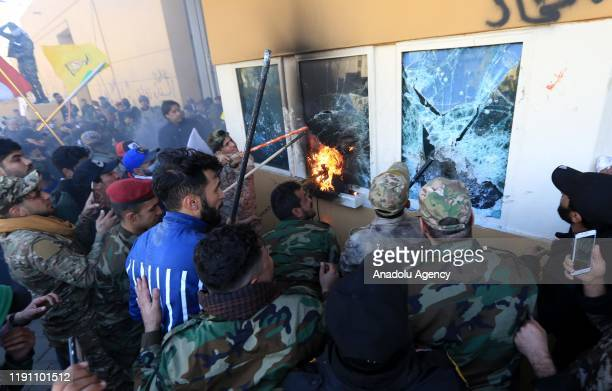 Outraged Iraqi protesters storm the US Embassy in Baghdad protesting Washington's attacks on armed battalions belong to Iranianbacked Hashd alShaabi...