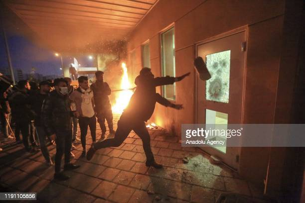 Outraged Iraqi protesters storm the U.S. Embassy in Baghdad, protesting Washington's attacks on armed battalions belong to Iranian-backed Hashd...