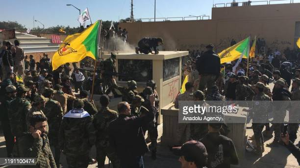 Outraged Iraqi protesters try to storm the US Embassy in Baghdad protesting Washington's attacks on armed battalions belong to Iranianbacked Hashd...