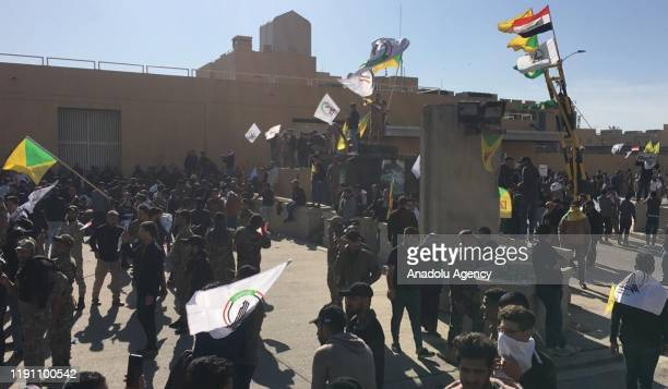 Outraged Iraqi protesters try to storm the U.S. Embassy in Baghdad, protesting Washington's attacks on armed battalions belong to Iranian-backed...