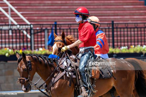 Outrider brings out a horse while wearing a mask for protection during the Covid19 Pandemic on Derby Day at Oaklawn Racing Casino Resort on May 2...