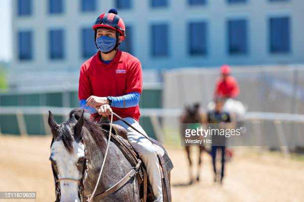 Outrider waits for a horse while wearing a mask for protection during the Covid19 Pandemic on Derby Day at Oaklawn Racing Casino Resort on May 2 2020...