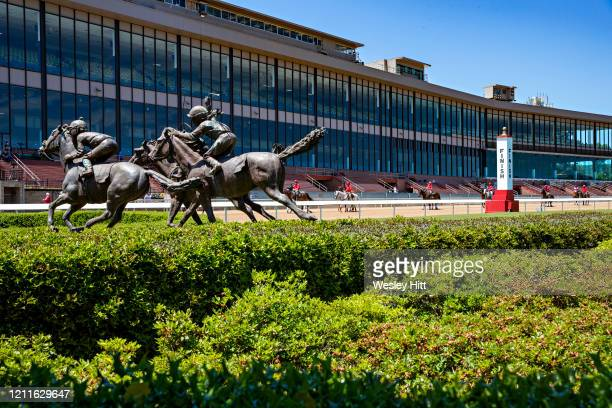 Outriders brings out horses fo the starting line during the Covid19 Pandemic in front of empty grandstands on Derby Day at Oaklawn Racing Casino...