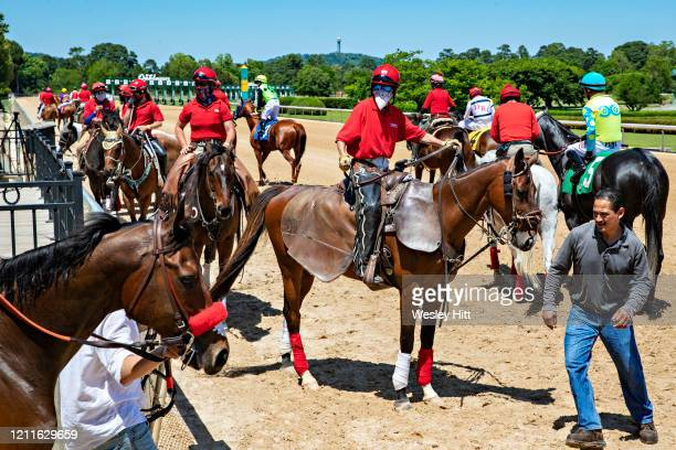 Outriders wait for a horse while wearing a mask for protection during the Covid19 Pandemic on Derby Day at Oaklawn Racing Casino Resort on May 2 2020...