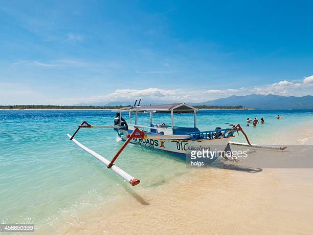 outrigger boat gili islands, indonesia - gili trawangan stock photos and pictures