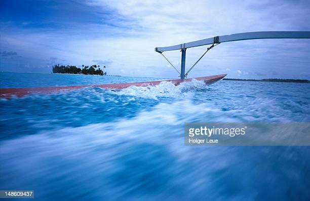 Outrigger canoe and Motu Island, Bora Bora Lagoon.