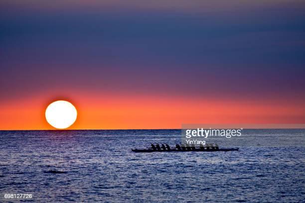 outrigger canoe at sunset, kailua-kona, hawaii - kailua beach stock photos and pictures